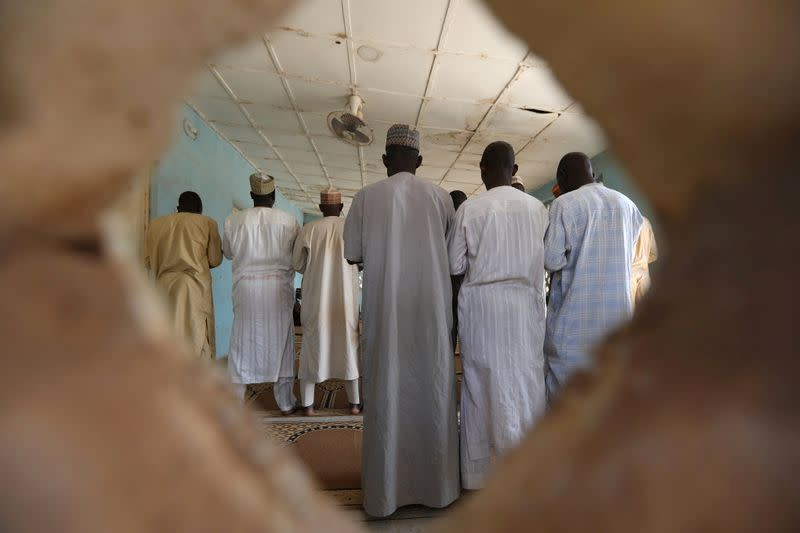People pray in a mosque at the Government Science school in Kankara
