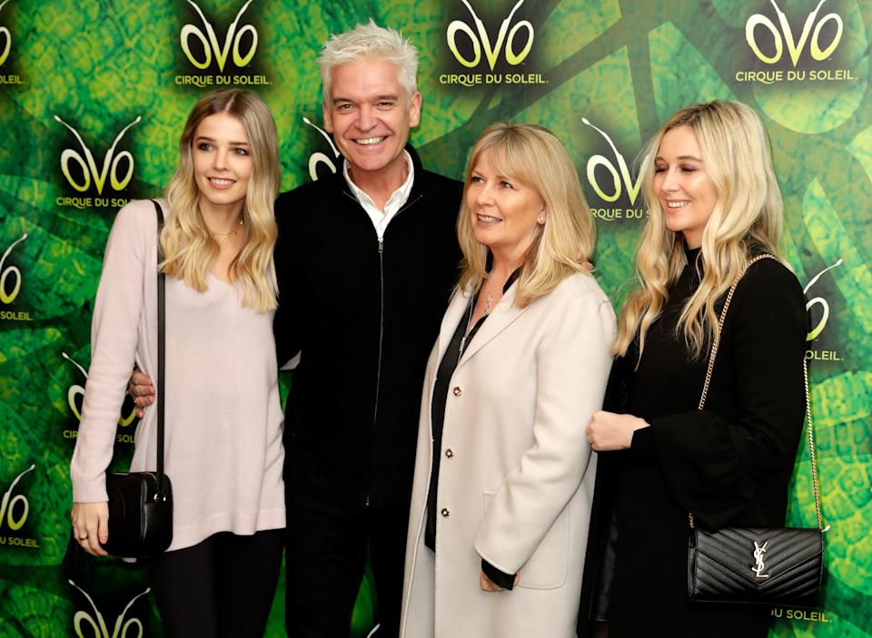 LONDON, ENGLAND - JANUARY 10:  Phillip Schofield (2ndL), his wife Stephanie Lowe (2ndR), Molly Lowe (L) and Ruby Lowe (R) attend the Cirque du Soleil OVO premiere at Royal Albert Hall on January 10, 2018 in London, England.  (Photo by John Phillips/Getty Images)