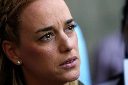 Lilian Tintori, wife of jailed opposition leader Leopoldo Lopez, talks to the media during a gathering outside of the offices of Venezuela's ombudsman in Caracas, Venezuela April 3, 2017. REUTERS/Carlos Garcia Rawlins