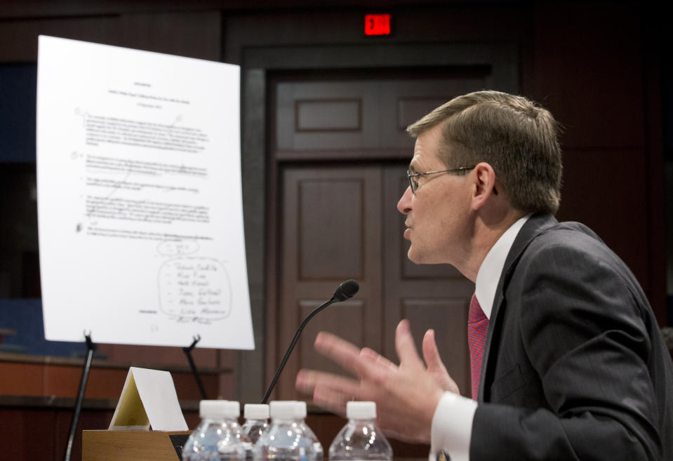 An unclassified talking points document is shown as former CIA Deputy Director Michael Morell  testifies on Capitol Hill in Washington on April 2, 2014, before the House Intelligence Committee.  Morell, who edited the widely debunked talking points on the 2012 Benghazi attack, answered questions from the House intelligence committee in a rare open session. The hearing provides Morell with a chance to explain why he deleted references to al-Qaida.  (Manuel Balce Ceneta/AP)