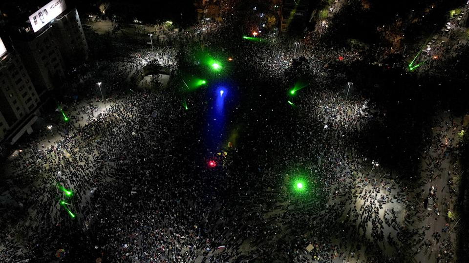 Thousands of people gather on the streets of Santiago, singing, dancing and lighting firecrackersGetty Images