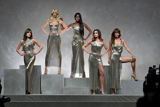 A Versace show in 2017 reunited '90s supermodels Carla Bruni, Claudia Schiffer, Naomi Campbell, Cindy Crawford and Helena Christensen — but Linda Evangelista said she was forced to decline the work. (Photo: Victor VIRGILE via Getty Images)