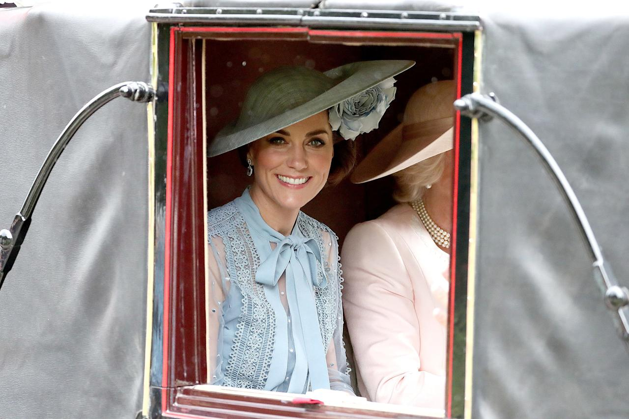 """<a href=""""https://people.com/tag/kate-middleton/"""">Kate Middleton</a> stunned ina cornflower blue dress with sheer sleeves by Ellie Saab and a matching Philip Treacy hat with a flower detail for the iconic horse race event."""