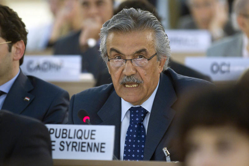 """Faysal Khabbaz Hamoui, Ambassador of the Permanent Representative Mission of the Syrian Arab Republic to Geneva, delivers his statement during a special session of the Human Rights Council at the European headquarters of the United Nations in Geneva, Switzerland, Friday, June 1, 2012. The Human Rights Council holds a special session on """"the deterioration of the human rights situation in the Syrian Arab Republic and the recent killings in Houla"""". (AP Photo/Keystone, Salvatore Di Nolfi)"""