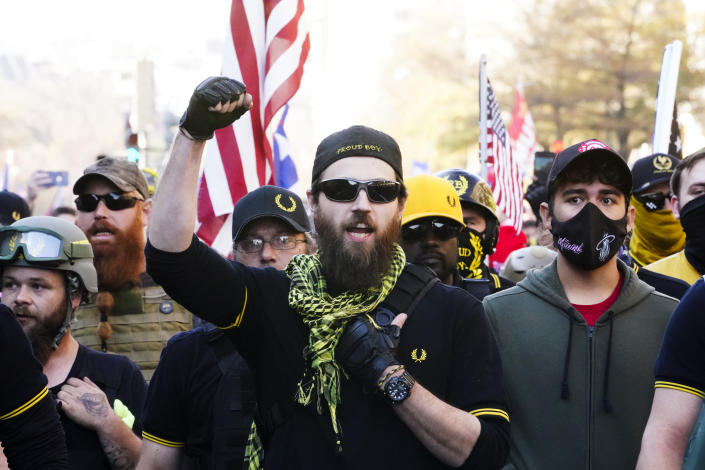 People identifying themselves as members of the Proud Boys join supporters of President Donald Trump as they march on Nov. 14, 2020, in Washington. (Jacquelyn Martin/AP)