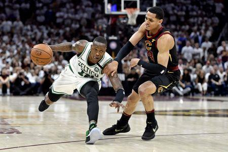 May 25, 2018; Cleveland, OH, USA; Boston Celtics guard Terry Rozier (12) drives to the basket against Cleveland Cavaliers guard Jordan Clarkson (8) during the fourth quarter in game six of the Eastern conference finals of the 2018 NBA Playoffs at Quicken Loans Arena. Mandatory Credit: David Richard-USA TODAY Sports