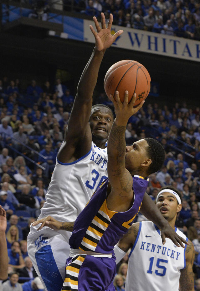 Kentucky's Julius Randle, left, goes up in an attempt to block the shot of Montevallo's Troran Brown during the first half of an exhibition NCAA basketball game, Friday, Nov. 4, 2013, in Lexington, Ky. (AP Photo/Timothy D. Easley)