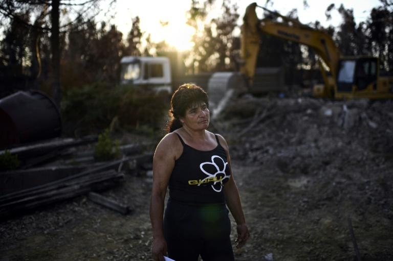 """We lost everything,"" said Edite Godinho, watching a bulldozer demolish the charred remains of her home in Vale da Nogueira, Portugal"