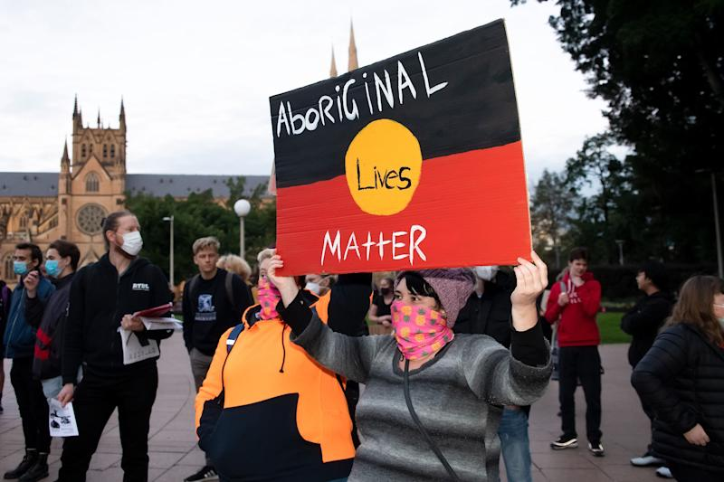 SYDNEY, AUSTRALIA - JUNE 02: Protesters hold up signs in Hyde Park during a 'Black Lives Matter' rally on 02 June, 2020 in Sydney, Australia. This event was organized to rally against aboriginal deaths in custody in Australia as well as in unity with protests across the United States following the killing of an unarmed black man George Floyd at the hands of a police officer in Minneapolis, Minnesota. (Photo by Speed Media/Icon Sportswire) (Photo: Icon Sportswire via Getty Images)
