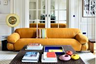 """<p>Originally designed by Gianfranco Frattini in 1970 and reissued in 2015, the <a href=""""https://www.tacchini.it/en/sofas/sesann/"""" rel=""""nofollow noopener"""" target=""""_blank"""" data-ylk=""""slk:Sesann sofa"""" class=""""link rapid-noclick-resp"""">Sesann sofa</a> flies under the radar. With its tubular metal frame and bulging cushions, this is the real cool-kid sofa to have.</p>"""