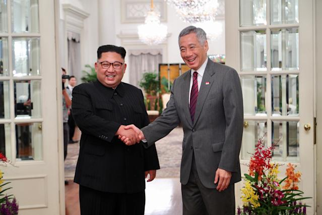 <p>North Korea's leader Kim Jong Un shakes hands with Singapore's Prime Minister Lee Hsien Loong at the Istana in Singapore, June 10, 2018 in this picture obtained from social media. (Photo: Singpore's Ministry of Communications and Information via Reuters) </p>