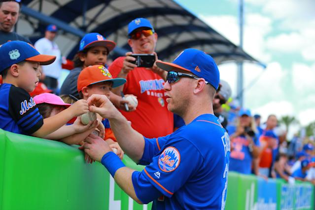<p>New York Mets player Todd Frazier signs for young fans before the baseball game against the Miami Marlins at First Data Field in Port St. Lucie, Fla., Feb. 25, 2018. (Photo: Gordon Donovan/Yahoo News) </p>
