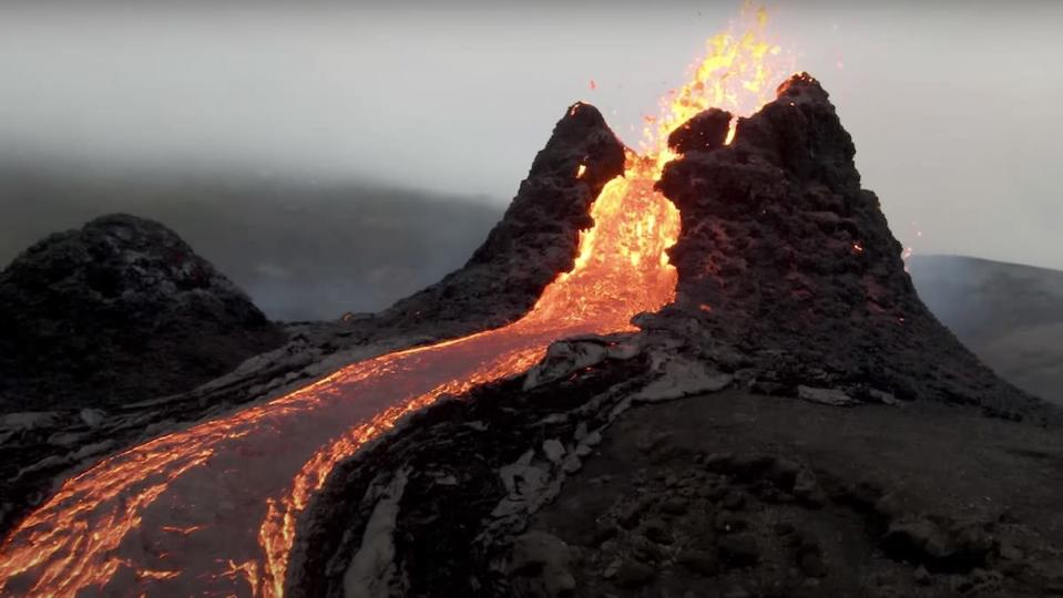 Up-close drone footage of a river of lava coming down from an active volcano that is still erupting