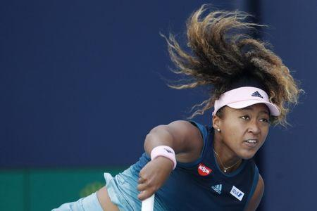 Mar 22, 2019; Miami Gardens, FL, USA; Naomi Osaka of Japan serves against Yanina Wickmayer of Belgium (not pictured) in the second round of the Miami Open at Miami Open Tennis Complex. Mandatory Credit: Geoff Burke-USA TODAY Sports