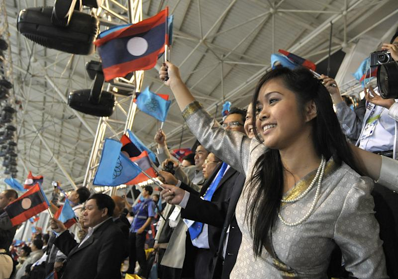 A Lao woman cheers at the opening cerenomy of the 25th Southeast Asian Games (SEAGAMES) in Vientiane on December 9, 2009. The 10-day biennial showpiece officially opened on December 9 in the capital Vientiane, with attention focused on medal hopefuls a head of the Asian Games in China in 2010. The region's biggest sport event will gather athletes from Brunei, Cambodia, Laos, Myanmar, Malaysia, Philippines, Singapore, Thailand, Vietnam, East Timor and Indonesia to compete for 390 gold medals. AFP PHOTO / LIU Jin (Photo credit should read LIU JIN/AFP via Getty Images)