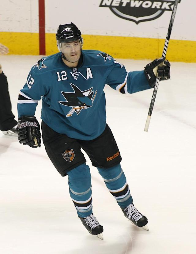 San Jose Sharks' Patrick Marleau reacts after scoring the winning goal in the shootout of an NHL hockey game against the Colorado Avalanche, Monday, Dec. 23, 2013, in San Jose, Calif. The San Jose Sharks beat the Colorado Avalanche 5-4. (AP Photo/George Nikitin)