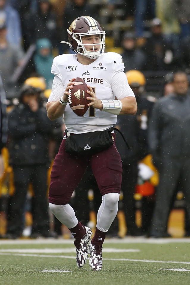 Texas State quarterback Tyler Vitt (11) looks for an open receiver during the first half of an NCAA college football game against Appalachian State Saturday, Nov. 23, 2019, in Boone, N.C. (AP Photo/Brian Blanco)