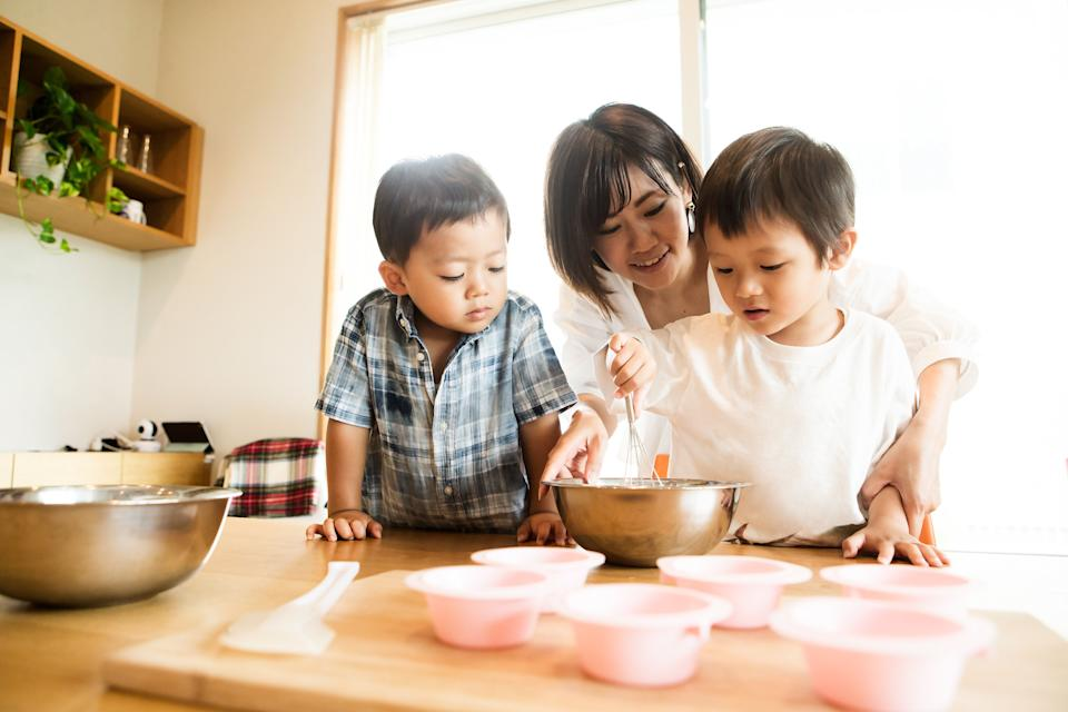 Try to broach the subject while you're doing a calm activity, such a cooking or baking. (Photo: Taiyou Nomachi via Getty Images)