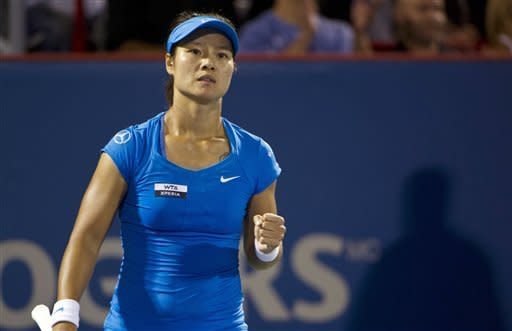 Li Na, from China, celebrates after winning the second set over Petra Kvitova, from the Czech Republic, during the final match at the Rogers Cup women's tennis tournament, Monday, Aug. 13, 2012, in Montreal. (AP Photo/The Canadian Press, Paul Chiasson)