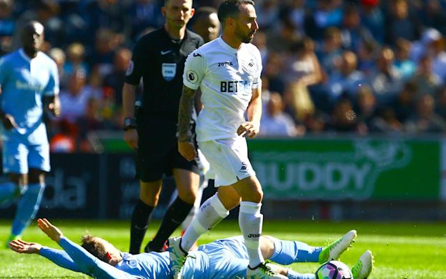 Swansea beat Stoke afterLeon Britton handed out a DVD chronicling the darkest days of the club before the Premier League millions started sloshing around south Wales - PA