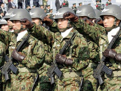 Japanese soldiers take part in a military parade at the Ground Self Defence Force's training ground in Asaka. Japan's defence minister has warned Tokyo could send troops to a chain of East China Sea islands at the centre of a territorial row with China if the simmering dispute escalated