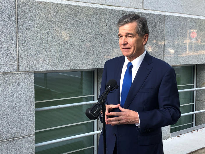 North Carolina Gov. Roy Cooper speaks to reporters, Tuesday, Oct. 5, 2021, outside of the Department of Transportation building in Raleigh, N.C., following a meeting of the Council of State (AP Photo/Gary D. Robertson)
