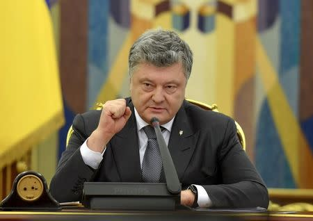 Ukrainian President Poroshenko speaks during a meeting of the country's Security and Defence Council in Kiev