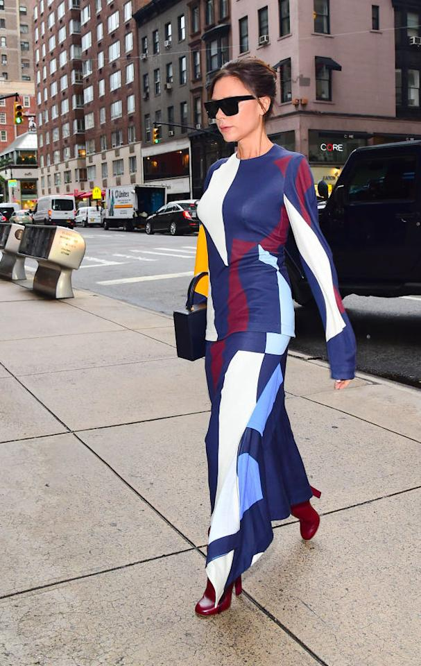 <p>Victoria Beckham was spotted in New York donning a seriously Instagrammable abstract dress accessorised with this season's must-have, the mini handbag. <em>[Photo: Getty]</em> </p>