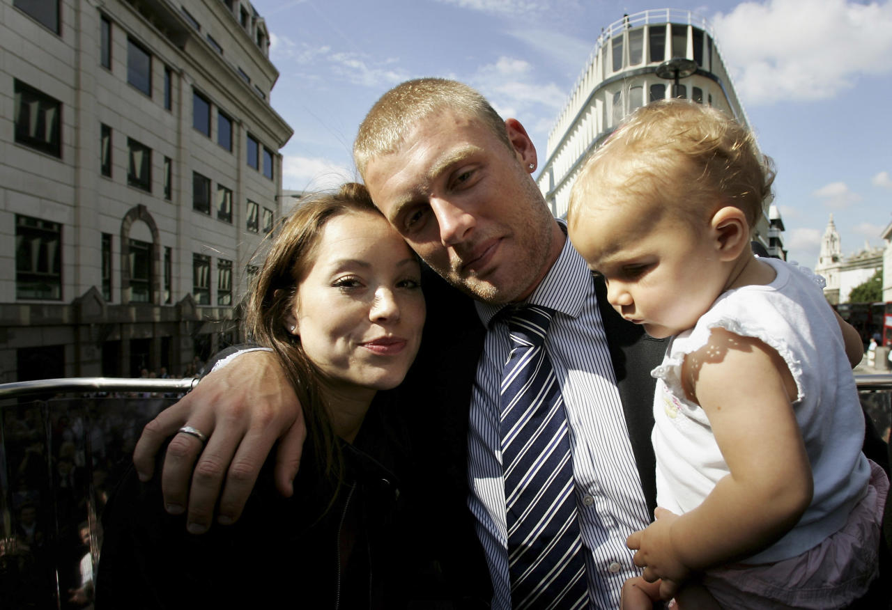 LONDON - SEPTEMBER 13:  (l-r) Rachael Flintoff, Andrew Flintoff and their daughter Holly pose for a photograph aboard the parade bus in Trafalgar Square as part of the Ashes victory celebration, September 13, 2005 in London.  (Photo by Tom Shaw/Getty Images)
