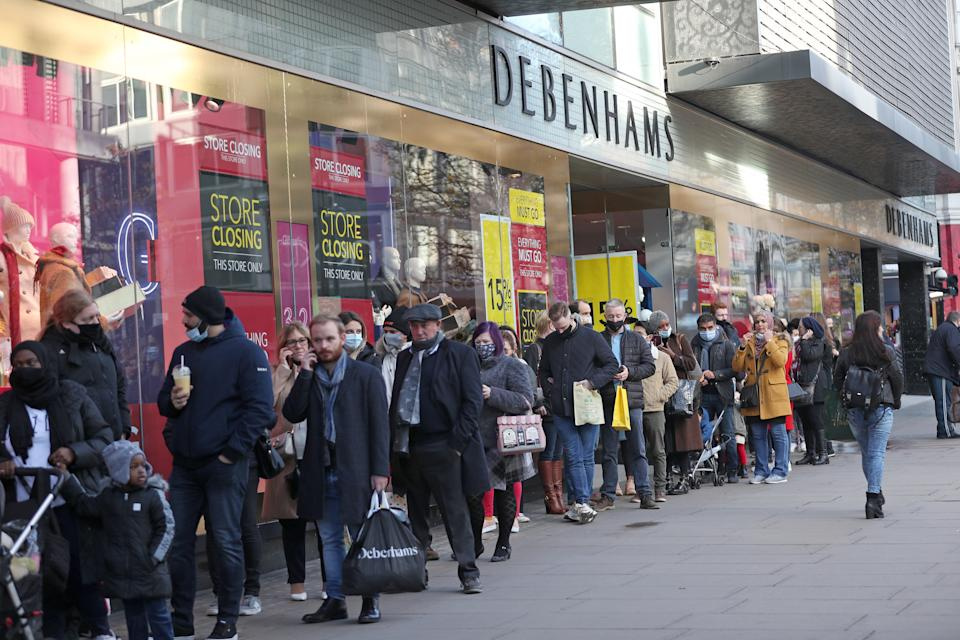 Shoppers queue outside Debenhams on Oxford Street in London on the first weekend following the end of the second national lockdown in England, with coronavirus restrictions being relaxed. (Photo by Yui Mok/PA Images via Getty Images)