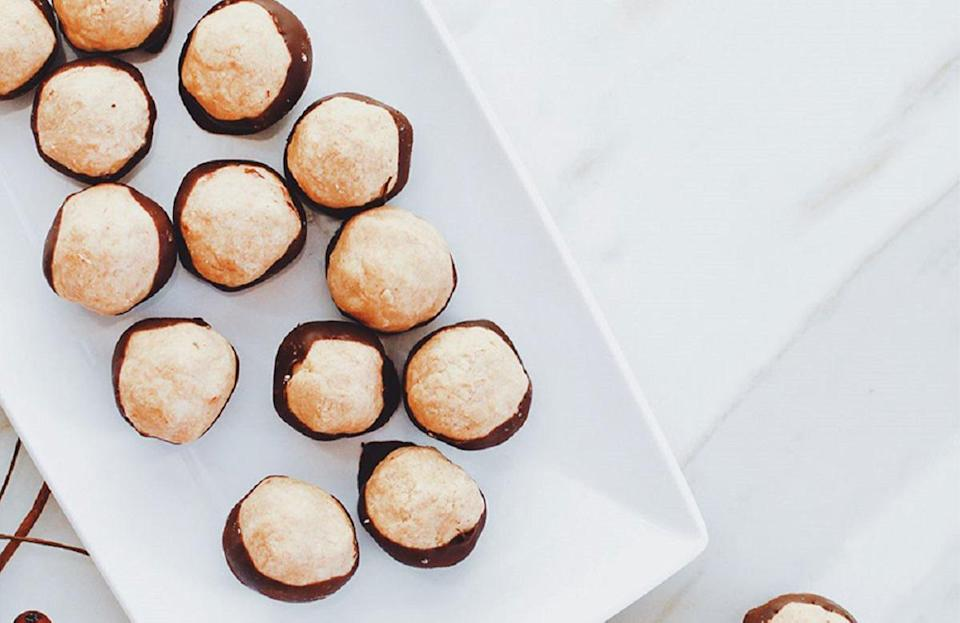 "<p>It's no secret that Ohio's most iconic dessert is buckeyes — its nickname is the Buckeye State. Frozen balls of peanut butter are dipped in chocolate to resemble the nuts that grow on buckeye trees. The dessert may be one of those <a href=""https://www.thedailymeal.com/cook/dishes-only-found-midwest?referrer=yahoo&category=beauty_food&include_utm=1&utm_medium=referral&utm_source=yahoo&utm_campaign=feed"" rel=""nofollow noopener"" target=""_blank"" data-ylk=""slk:foods you can only find in the Midwest"" class=""link rapid-noclick-resp"">foods you can only find in the Midwest</a>, but now you can make the treat at home with this delicious recipe.</p> <p><a href=""https://www.thedailymeal.com/best-recipes/buckeyes-recipe?referrer=yahoo&category=beauty_food&include_utm=1&utm_medium=referral&utm_source=yahoo&utm_campaign=feed"" rel=""nofollow noopener"" target=""_blank"" data-ylk=""slk:For the Buckeyes recipe, click here"" class=""link rapid-noclick-resp"">For the Buckeyes recipe, click here</a>.</p>"