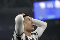 Juventus' Cristiano Ronaldo reacts after failing to score during the Champions League, round of 16, second leg, soccer match between Juventus and Porto in Turin, Italy, Tuesday, March 9, 2021. (AP Photo/Luca Bruno)