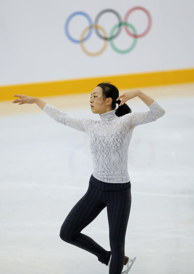 Mao Asada of Japan skates during a practice session at the figure stating practice rink at the 2014 Winter Olympics, Monday, Feb. 17, 2014, in Sochi, Russia. (AP Photo/Vadim Ghirda)