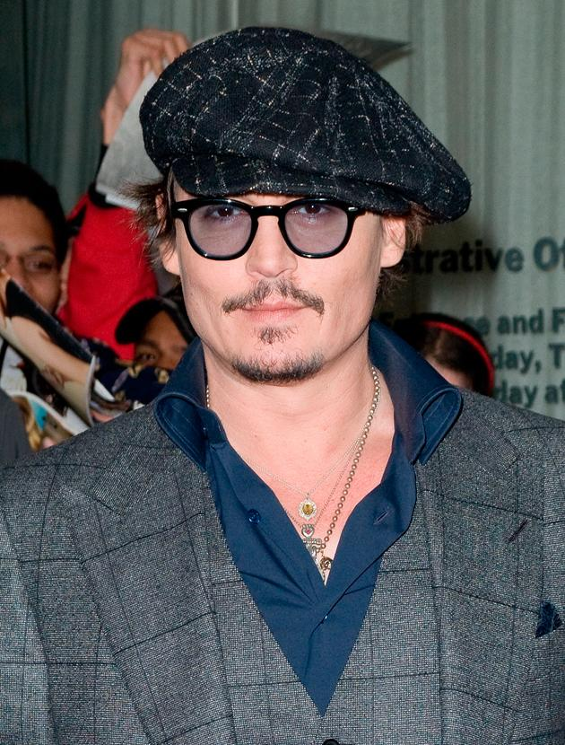 Johnny Depp photos: Another day and it's another hat, we're not sure about this one though...