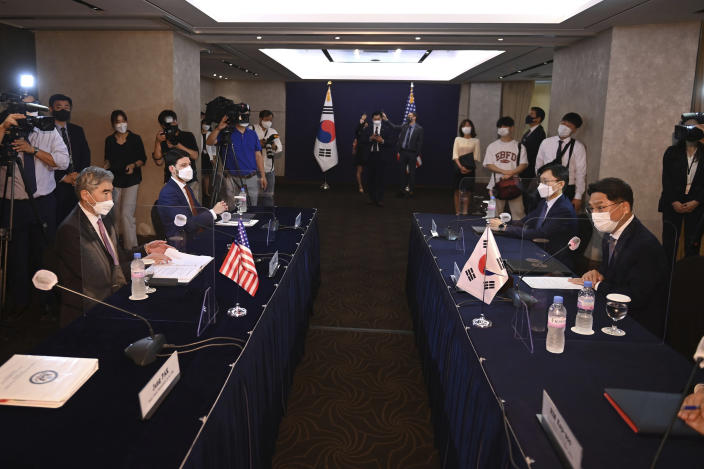 U.S. special representative for North Korea Sung Kim, left, talks with South Korea's Special Representative for Korean Peninsula Peace and Security Affairs Noh Kyu-duk, right, during their bilateral meeting at a hotel in Seoul Monday, June 21, 2021. (Jung Yeon-je/Pool Photo via AP)