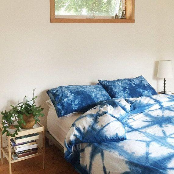 "Shibori is the ""it"" textile art of the moment. This <a href=""https://www.etsy.com/listing/261001279/hand-dyed-indigo-bedding-shibori-bedding?ga_order=most_relevant&ga_search_type=all&ga_view_type=gallery&ga_search_query=shibori%20duvet%20cover&ref=sr_gallery_10"" target=""_blank"">hand-dyed bedding</a> is a beautiful addition to a minimalist-designed bedroom."