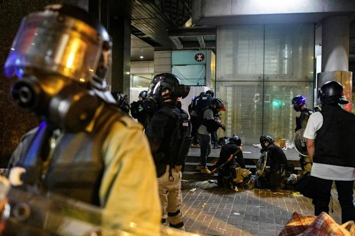 Police responded with sustained volleys of tear gas, scattering protesters with water cannon trucks and making dozens of arrests (AFP Photo/Anthony WALLACE)