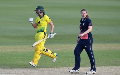 Australia's Jess Jonassen (L) reacts after she hit the winning runs from the bowling of England's Anya Shrubsole (R) to give Austrlia victory - Credit: EPA