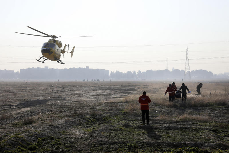 Rescue team work at the scene where an Ukrainian plane crashed in Shahedshahr southwest of the capital Tehran, Iran, Wednesday, Jan. 8, 2020. (Photo: Ebrahim Noroozi/AP)