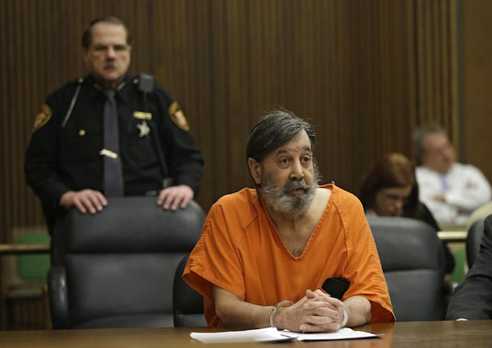 John Donald Cody speaks during his sentencing on racketeering, theft, money laundering charges Monday, Dec. 16, 2013, in Cleveland. Cody, using the stolen identity Bobby Thompson, was sentenced to 28 years in prison for defrauding donors of up to $100 million in 41 states through the United States Navy Veterans Association, a charity he ran in Tampa, Fla. (AP Photo/Mark Duncan)