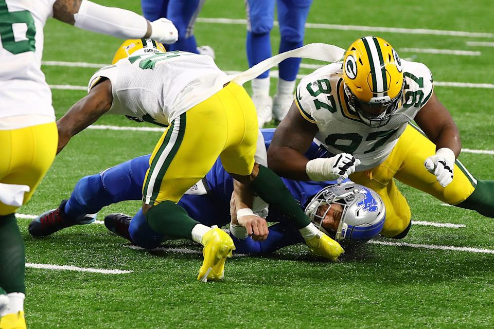 Matthew Stafford injured his ribs on this crunching tackle in the fourth quarter from Packers' Kenny Clark (97).