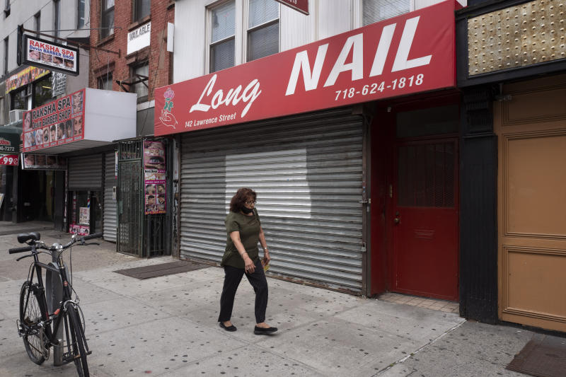 A Brooklyn nail salon remains closed during the coronavirus pandemic, Tuesday, June 30, 2020, in New York. New York City may begin Phase 3 reopening as early as Monday, July 6 which will allow nail salons to reopen. (AP Photo/Mark Lennihan)