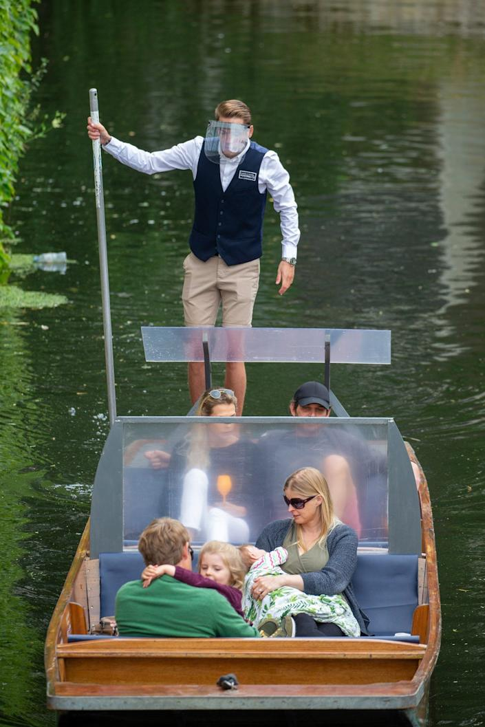 Picture dated June 19th shows a new style punt being tested for the first time on the River Cam in Cambridge .The punt has been fitted with perspex screens to help with social distancing between different households. Traditional punts in Cambridge have been fitted with PERSPEX screens to help with social distancing between different households. Punts have looked the same for the last 120 years, but now Lets Go Punting and The Traditional Punting Company have given their boats a makeover so they can safely re-open - Geoff Robinson