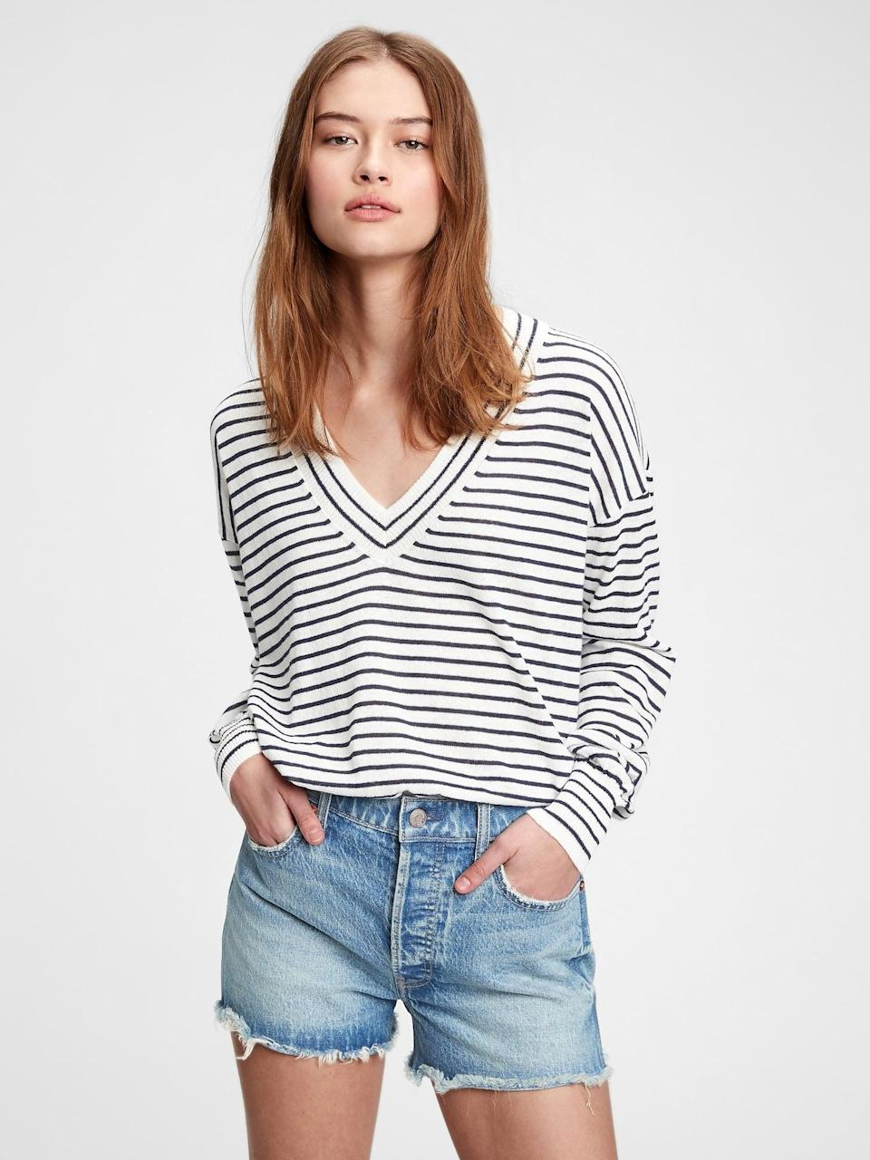 <p>It doesn't feel like spring without a navy and white striped sweater. Pair this <span>Gap Lightweight V-Neck Sweater</span> ($35, originally $60) with a pair of black capris for a chic retro look.</p>