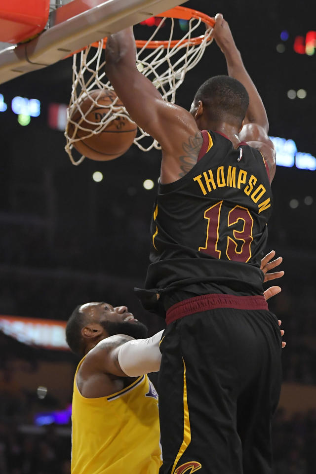 Cleveland Cavaliers center Tristan Thompson, right, dunks over Los Angeles Lakers forward LeBron James during the first half of an NBA basketball game Monday, Jan. 13, 2020, in Los Angeles. (AP Photo/Mark J. Terrill)