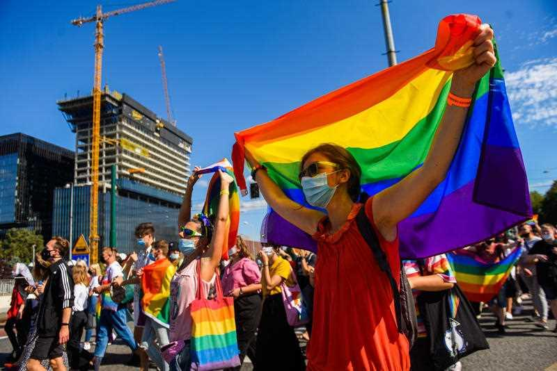 A supporter wears a protective face mask, holding a rainbow flag during the march. LGBT supporters participate in the 4th Edition of the Equality Parade in Katowice, guarded by hundreds of police officers and attracting more than 1500 participants.