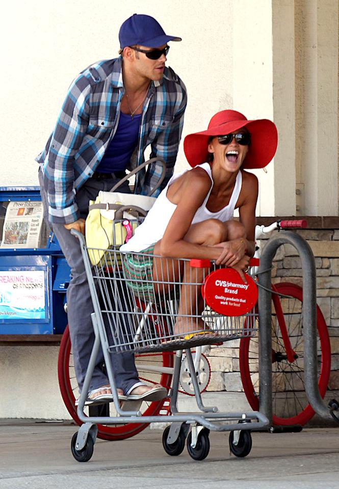 "To be young, in love ... and at a pharmacy. ""Twilight"" actor Kellan Lutz had some shopping cart fun with his model girlfriend Sharni Vinson outside a CVS on Tuesday. (9/18/2012)"