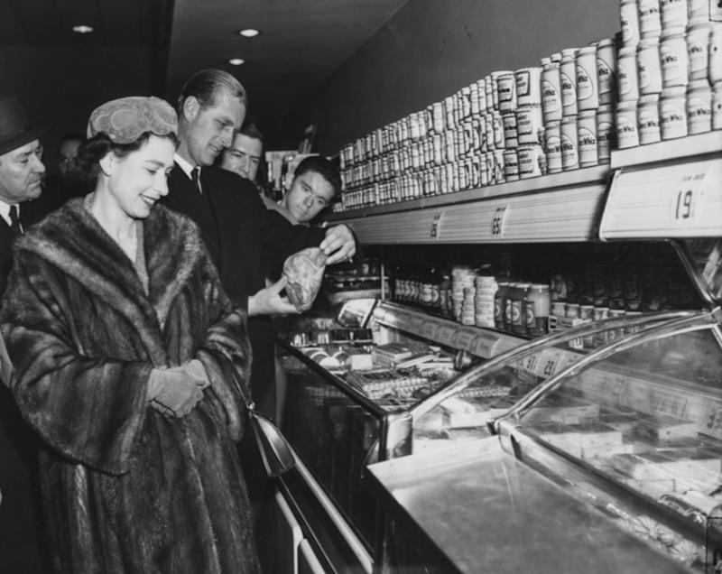 Queen Elizabeth II and Prince Philip, Duke of Edinburgh, inspecting produce at a frozen meat center inside of a supermarket at the Giant Food Shopping Center in Queenstown, Maryland during their royal tour of the United States, October 1957.