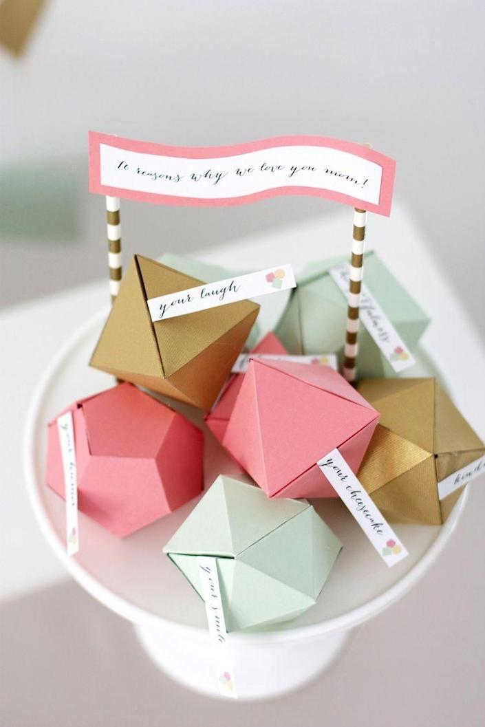 """<p>Sweet, heartfelt messages hidden within colorful card stock make this project equally thoughtful and beautiful. She'll be wiping away tears.</p><p><strong>Get the tutorial at <a href=""""https://www.kristimurphy.com/blog/mothers-day-diy"""" rel=""""nofollow noopener"""" target=""""_blank"""" data-ylk=""""slk:Kristi Murphy"""" class=""""link rapid-noclick-resp"""">Kristi Murphy</a>.</strong></p><p><a class=""""link rapid-noclick-resp"""" href=""""https://go.redirectingat.com?id=74968X1596630&url=https%3A%2F%2Fwww.walmart.com%2Fsearch%2F%3Fquery%3Dcardstock&sref=https%3A%2F%2Fwww.thepioneerwoman.com%2Fholidays-celebrations%2Fgifts%2Fg32307619%2Fdiy-gifts-for-mom%2F"""" rel=""""nofollow noopener"""" target=""""_blank"""" data-ylk=""""slk:SHOP CARD STOCK"""">SHOP CARD STOCK </a></p>"""