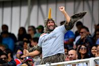 A New Zealand fan enjoys the atmosphere. (Photo by Clive Mason/Getty Images)